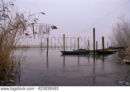 Boats In A Frozen Creek Near Hank