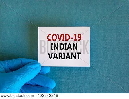 New Covid-19 Indian Variant Strain Symbol. Hand In Blue Glove With White Card. Concept Words 'covid-