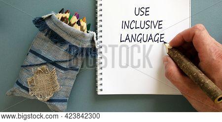 Use Inclusive Language Symbol. Businessman Writing Concept Words 'use Inclusive Language' On White N