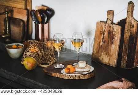 Two Glasses Of Orange Or Amber Wine And Appetizers