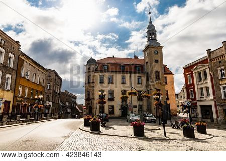 Bougszow-gorce, Poland - July 7 2020: Facade Of Town Hall At Market Square At Sunny Cloudy Morning