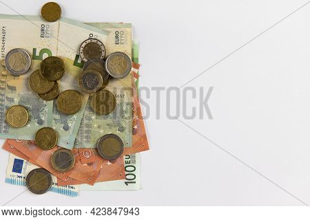 Background From Euro Money, Copy Space. Few Banknotes And Coins, Different Denomination. Concept Cas