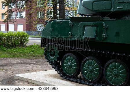 Close-up Of Tank Parts, Iron Wheels, Tank Track, Tank Undercarriage, Metal Wheels Of Combat Power.