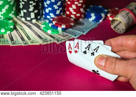 Poker Cards With With Four Of A Kind Win Combination. Close Up Of Gambler Hand Takes Playing Cards I