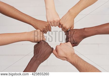 Multiethnic People Holding Hands In A Circle Together, Multiethnic Business Team Promising Help And