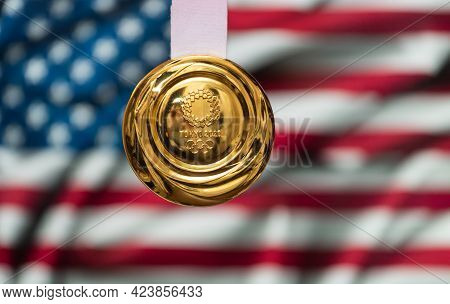 April 25, 2021 Tokyo, Japan. Gold Medal Of The Xxxii Summer Olympic Games 2020 In Tokyo On The Backg