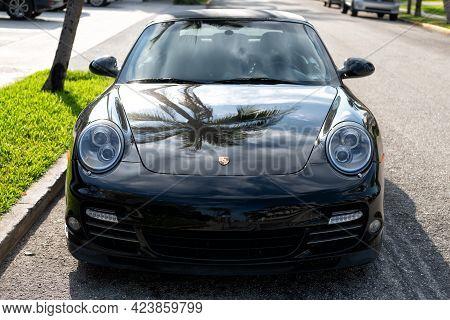 Palm Beach, Florida Usa - March 21, 2021: Black Porsche 911 Cabriolet. Front View.