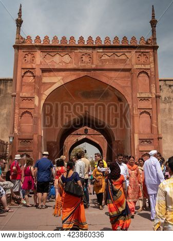 Agra, India - March, 28, 2019: Exterior Shot Of An Entrance Gate With Tourists At Red Fort