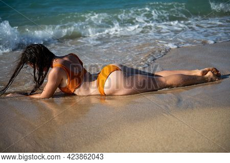 Sexy Woman Relax On The Beach. Sand, Cloudy Sky And Blue Sea Of Tropical Beach. Vacation At Paradise