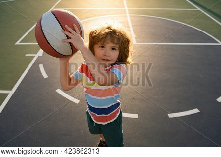 Kid Playing Basketball. Child Boy Preparing For Basket Ball Shooting. Best Sport For Kids. Active Ki