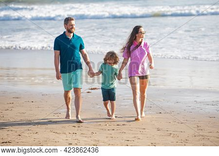 Family Walking On Beach. Mother Father And Child Son Spending Time Together. Family Summer Vacation.
