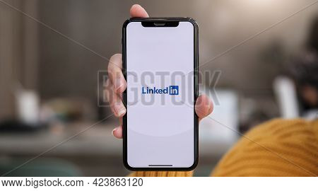 Chiang Mai, Thailand, Dec 12, 2020 : A Women Holds Apple Iphone Xs With Linkedin Application On The