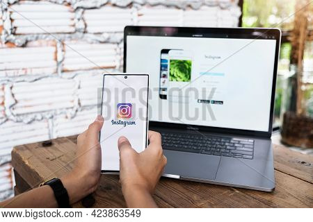 Chiangmai, Thailand - June 06, 2021: A Woman Holding Smartphone With Instagram Application On The Sc