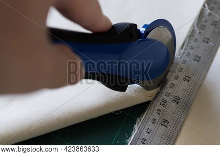 On The Mat For Patchwork Sewing There Are  Knife For Patchwork, A Ruler,