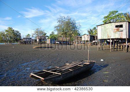 Canoe At Village River Coast