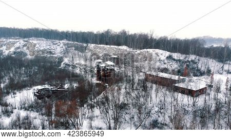 Drone View Of Liban Quarry Kamieniolom In Krakow, Poland During The Winter Season. Old Rusty Machine