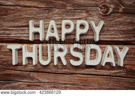 Happy Thursday Text Message On Wooden Background