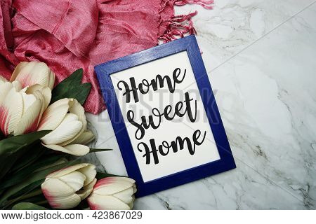 Home Sweet Home Calligraphy And Pink Flower Flat Lay On Marble Background