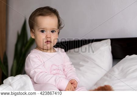Authentic Portrait Cute Caucasian Little Infant Chubby Baby Girl Or Boy In Pink Sleepy Upon Waking L