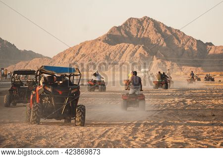 Quad Bikes Safari In The Desert, Egypt. Safari Trip Through Egyptian Desert Driving Atv.