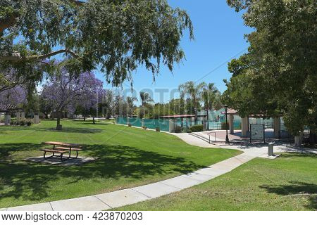 BREA, CALIFORNIA - 9 JUN 2021: The Ralph Barns Bandstand in City Hall Park, with The Plunge and Playground in the background.