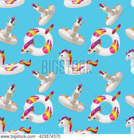 Inflatable Circle Or Ring For Kids Rainbow Unicorn For Floating In Summer Vacation Isolated On Blue