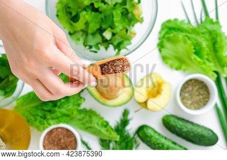 Woman Cooking Salad Of Fresh Green Vegetables And Herbs. Cooking Healthy Diet Or Vegetarian Food. Fe