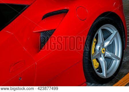 Bangkok, Thailand - 06 Jun 2021 : Close-up Of Rear Wheel, And Rim Of Red Metallic Ferrari Car. Selec