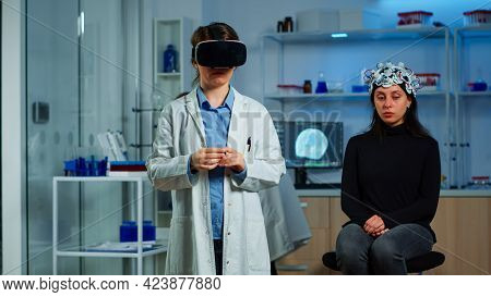 Laboratory Doctor Experiencing Virtual Reality Using Vr Goggles In Medical Neurological Research Lab