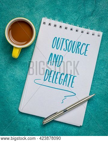 outsource and delegate advice - handwriting in a spiral sketchbook with a cup of coffee, business, time management and productivity concept