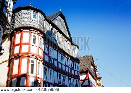 Cityscape Of The German City Of Marburg With Historical Townhall And Market Place. Details Of Marbur