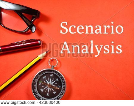 Business Concept. Text Scenario Analysis With Pen,glasses,pencil And Compass On Red Background.