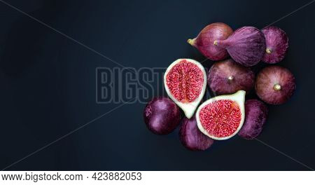 Fresh Ripe Figs On Dark Background. Violet Figs With Copyspace Close Up. Creative Food Photo