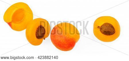 Apricot Half And A Whole Isolated On White Background. Fresh Apricots Fruit Creative Layout