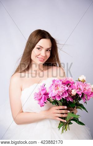 Beautiful Young Woman With Delicate Peony Flower.