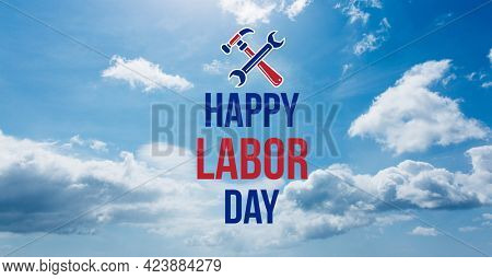 Happy labor day text and tools against clouds in blue sky. american labor day template background design concept