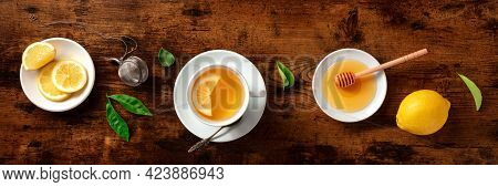 Tea With Lemon And Honey Panorama, Overhead Flat Lay Shot. Organic Lemons With Green Leaves And The