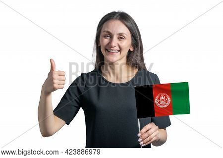 Happy Young White Woman Holding Flag Of Afghanistan And Shows The Class By Hand Isolated On A White
