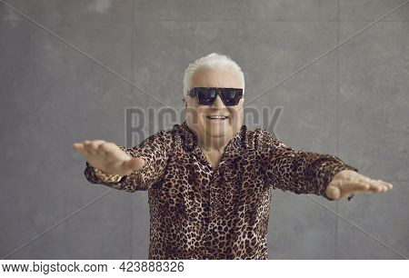 Studio Portrait Of A Funny Happy Rich Chubby Pensioner Enjoying An Active Fitness Workout