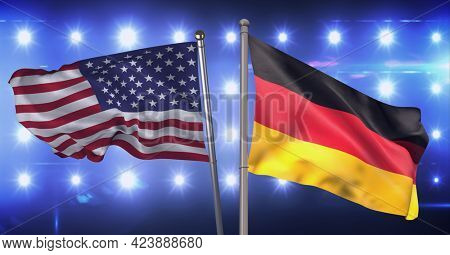 Composition of billowing american flag and german flag against wall of spotlights. patriotism, independence and celebration concept digitally generated image.