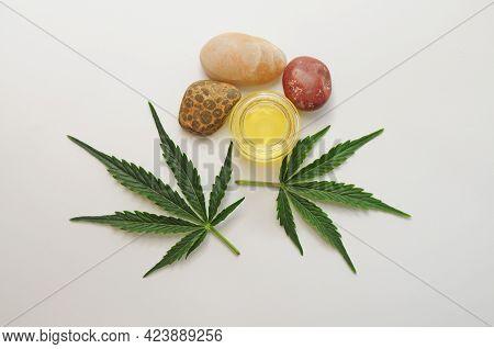 Marijuana Leaves, Cbd Oil, Sea Stones, Spa Recreation. Fresh Cannabis Leaves Close Up, Isolated On W