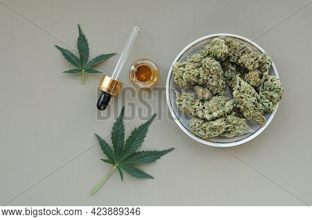 Marijuana Buds, Leaves And Resin, Flat Lat, Top View. Cannabis Flowers On Grey Background. Hemp Recr