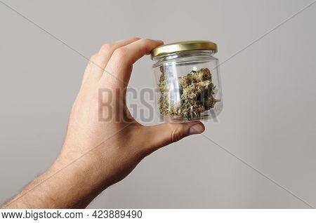 Cannabis Buds In Glass Jar. Eco Storage. Medicinal Marijuana Usage. Hemp Recreation, Pastime Concept