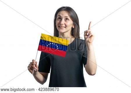 Happy Young White Woman Holding Flag Of Venezuela And Points Thumbs Up Isolated On A White Backgroun
