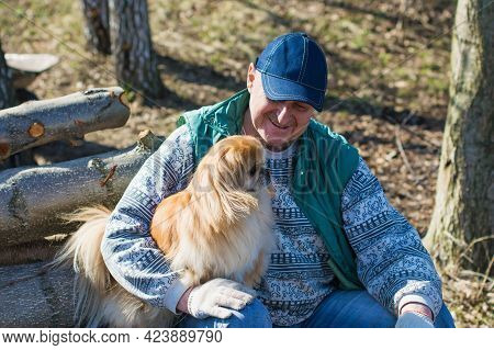 Senior Man With A Red Little Dog Outdoor, Man Retired, Lifestyle Of Older People