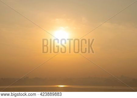 Stock Photo Of Beautiful Calm And Golden Sunset Scene, Sunlight Reflected In Lake Water. Picture Cap