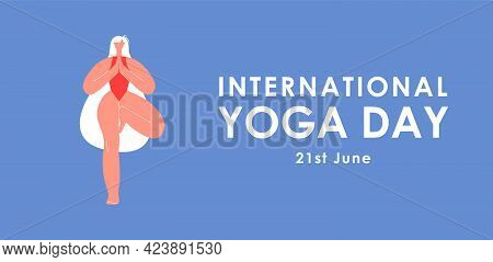 International Yoga Day. Young Girl Doing The Tree Pose In Yoga. Woman In The Vrksasana Pose. Healthy
