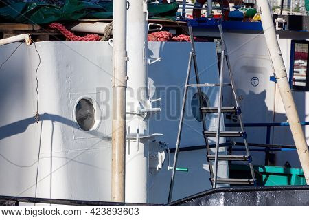 Close-up Of A Tugboat Moored For Repair At The Dock