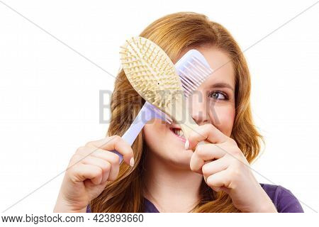 Haircut Coiffure Haircare Concept. Woman With Long Brown Wavy Hair Holding Brush And Comb.