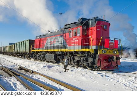 Sortavala, Russia - March 10, 2021: Russian Shunting Diesel Locomotive Tem18dm With Freight Train On